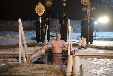 russian president vladimir putin strips   plunges