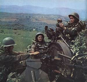 Female soldier of the Albanian People's Army operating a ...