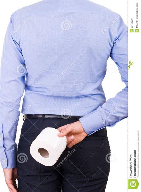businessman holding toilet paper    stock
