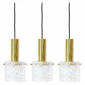 Set of three glass and brass pendant lights by kalmar