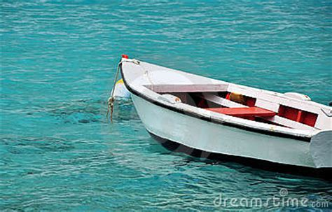 why ship floats on water and doesn t sink white row boat in clear blue water royalty free stock