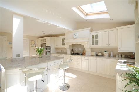 stunning ivory painted kitchen with kashmir white granite