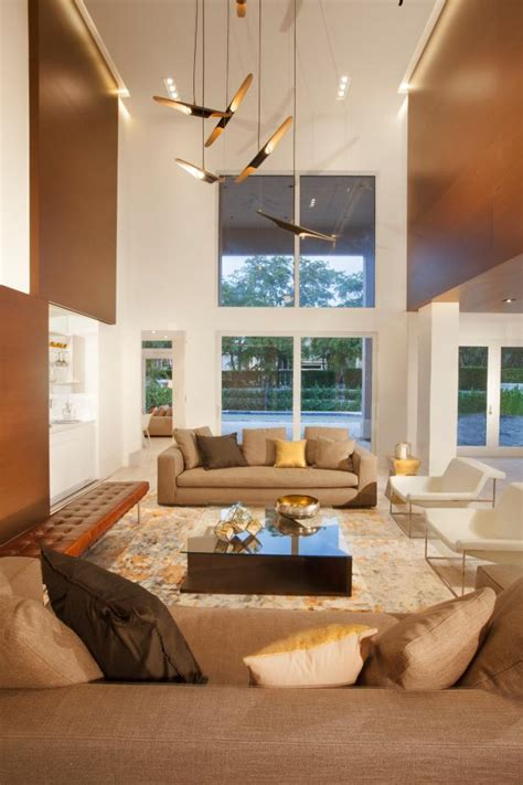 chic open living room features strong geometric shapes assorted seating hgtv