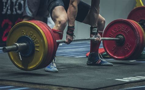 powerlifting kettlebells into bodybuilding workout kettlebell snatch deadlifts any academy program single leg russian exercises