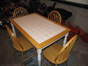 65 wooden kitchen table with inlaid tiles and four chairs