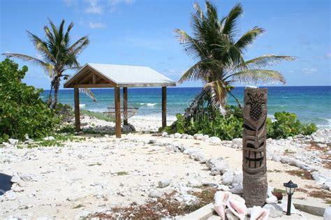 Tropical Island Tiki Hut Ocean View Scene Stock Photo
