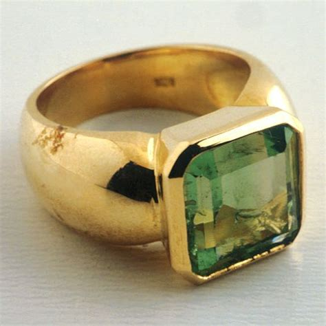 mens gold ring featuring  colombian emerald mister