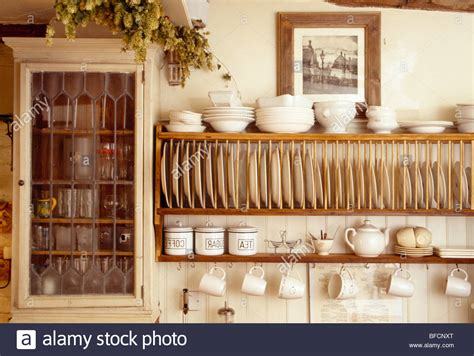 close   cream bowls  wooden plate rack  small wall stock photo alamy