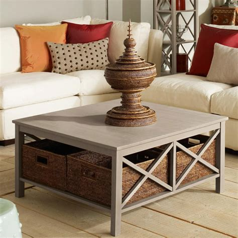 A storage coffee table with drawers or shelves can come in handy. Saltire Large Square Coffee Table with Storage - OKA