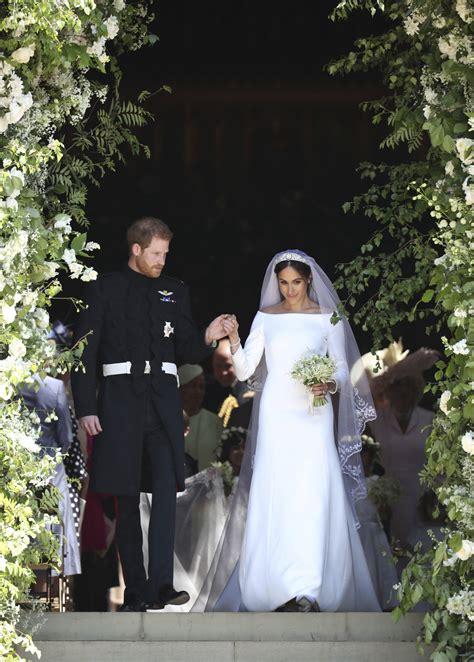 meghan markle marries prince harry wearing  wedding dress