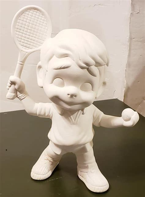 """The series follows the growth of sixteen years old boys and girls and the challenges faced by badminton club of their school. Unpainted Ceramic Boy with Tennis Racket and Ball 9 """" tall - U PAINT by trinketsfromanattic on ..."""