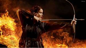 Katniss Everdeen With Her Bow Aiming At Something Wallpaper