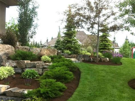 great landscaping ideas evergreen boulder landscape great yard ideas landscape pinterest evergreen landscaping