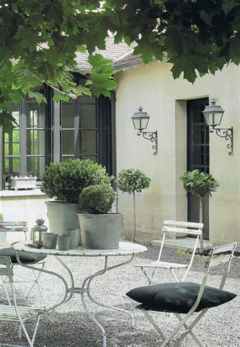 classic courtyard  french bistro style white garden