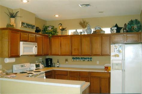 decorating ideas for kitchen cabinet tops the tricks you need to for decorating above cabinets
