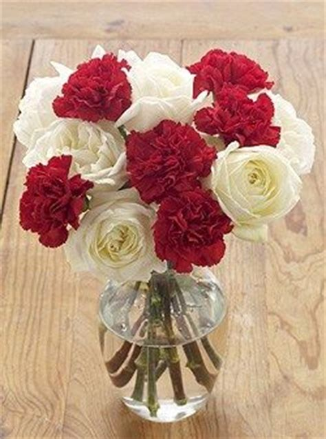 white roses  red carnations  bridesmaid