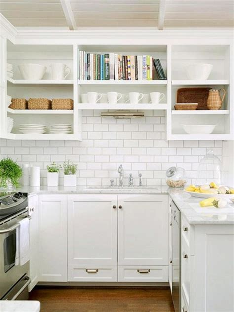 backsplash ideas for white kitchen cabinets bright small kicthen with marble countertop wooden