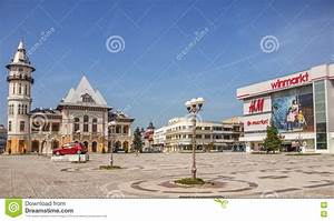 Buzau Palace And Winmarkt And H U0026m Market From Buzau Romania And Dacia Square Editorial Stock
