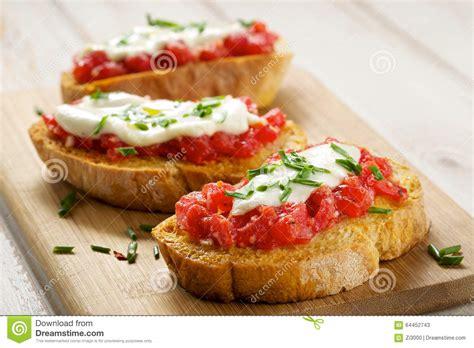 canape appetizer tomato bruschetta with mozzarella cheese and fresh chive