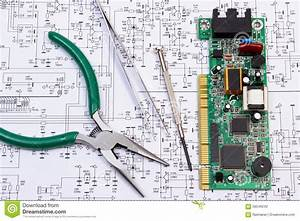 Printed Circuit Board And Precision Tools On Diagram Of Electronics  Technology Stock Photo