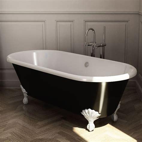 baignoire ilot en fonte 170x77 cm peinte en noir pieds blancs