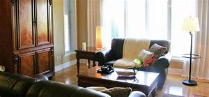 Basic rules of furniture arrangement groomed home for Couch and sofa table in front of window