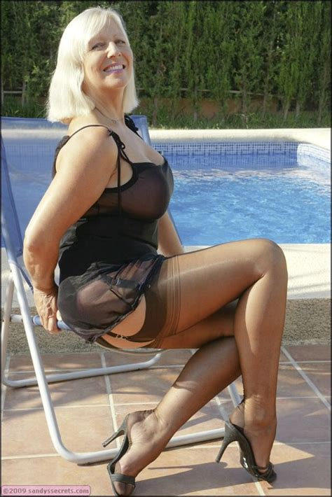 Playful Mature Sandy Spain Splashing In The Pool In Seamed