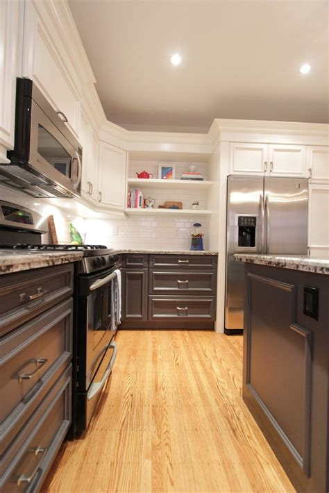 Modern kitchen boasts white flat front upper cabinets and brown oak veneer bottom cabinets adorned with nickel pulls paired with white quartz countertops and a silver and gray mosaic tile backsplash. 17 Best images about white upper dark lower cabinets on ...