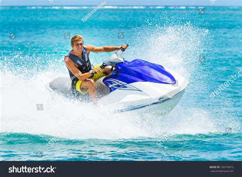 Fast Boat Orange Beach by Young Man On Jet Ski Tropical Stock Photo 158192810