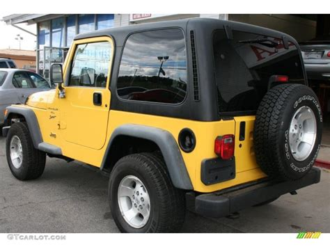 yellow jeep interior 2001 solar yellow jeep wrangler sport 4x4 36407092 photo