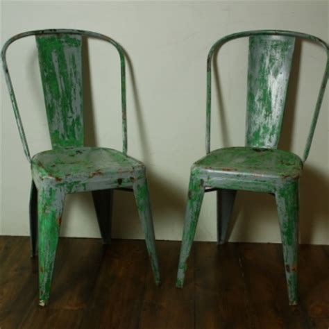 pair of vintage metal 1920s tolix cafe chairs
