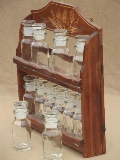 vintage kitchen spice rack carved wheat wall shelf  glass bottles  spices