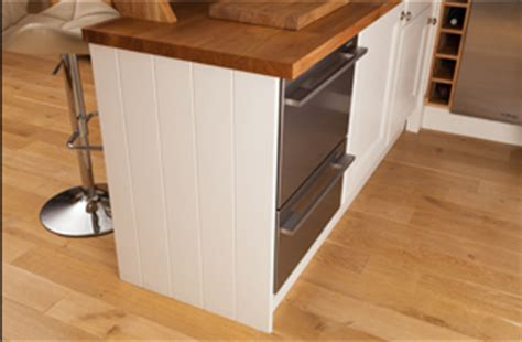 how to install kitchen cabinet end panels installing cabinet end panels in solid oak kitchens 9441