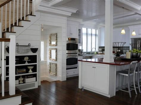 Coffered ceiling w/ beadboard, white cabinets, dark