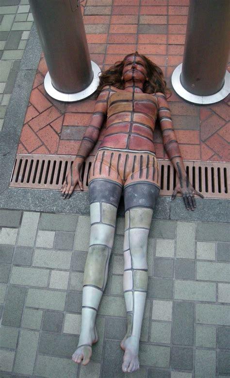 statues metallic body painting  cat