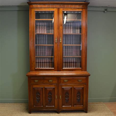 large victorian solid walnut antique bookcase  cupboard
