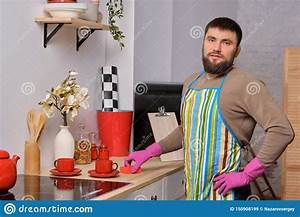 Housecleaning Duties Young Handsome Bearded Man In The Kitchen Wearing Apron