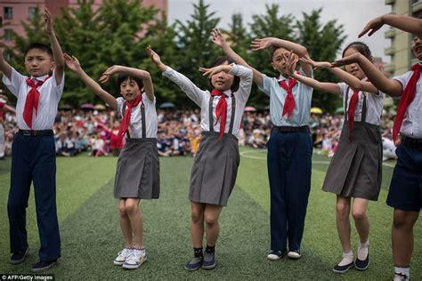north korean school children play  imitation aks