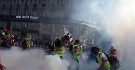 yellow vest protesters  paris police face