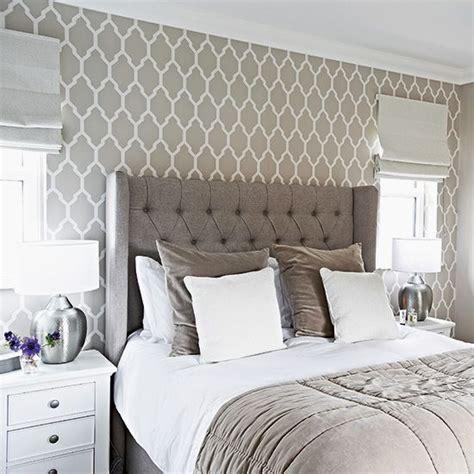 traditional grey bedroom  patterned wallpaper