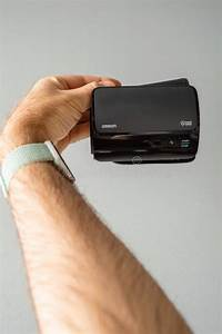 Man Holding Electronic Omron Blood Pressure Monitor Evolv