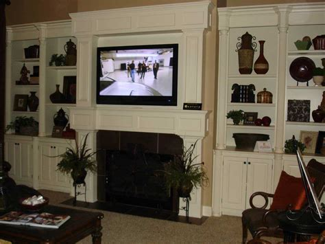 tv  fireplace design  problems  pros  cons