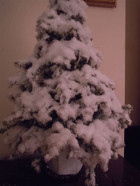 snowiest fake tree snow tree take cheap tree spray with glue add some torn cotton balls spray with glue