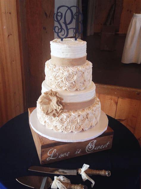 rustic wedding cake  burlap  buttercream rosettes