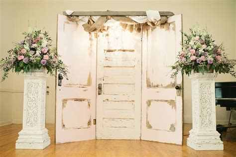 shabby chic wedding backdrop ideas kelsey and carder wed in front of vintage door panels a unique and shabby chic look photo by