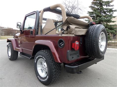jeep wrangler maroon lifted hi lift jack co jacks for off road farm and rescue autos