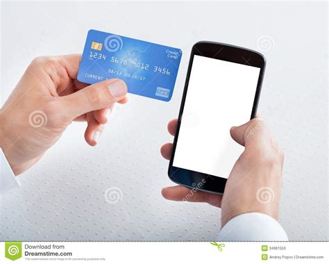 merchant credit card verification phone number holding credit card and cell phone stock photos