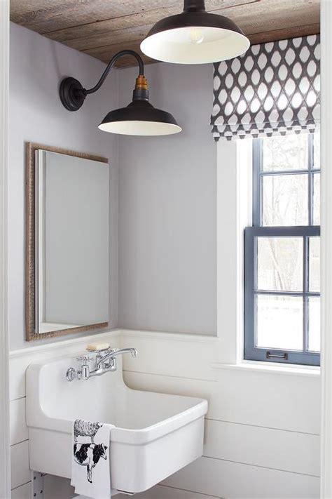 white shiplap bathroom wall  vintage towel hooks
