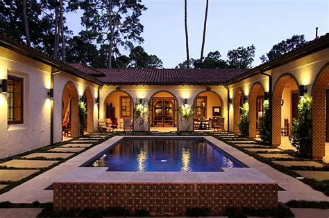 spanish swimming pool mediterranean house plans hacienda style  courtyard  architecture
