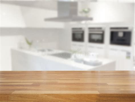 empty table  blurred kitchen background stock photo
